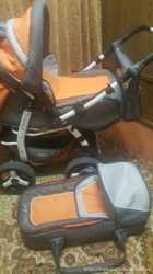 Детская коляска-трансформер Adamex Young с перекидной ручкой